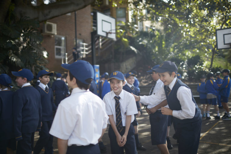 Junior Students enjoying a conversation on the playground